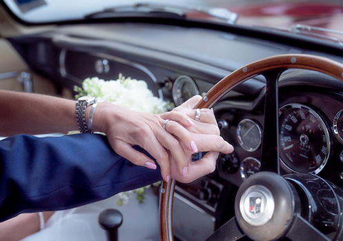 inside shot of vintage Aston Martin at wedding in Devon.