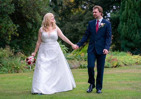 Bride and groom on the grounds at Larkbeare House.