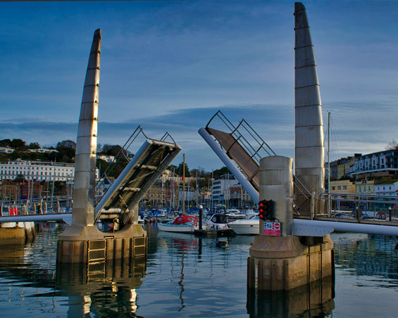 The footbridge at Torquay harbour at sunrise.