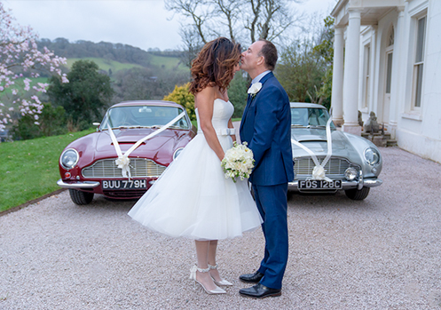 vintage Aston Martin's at wedding in Devon.