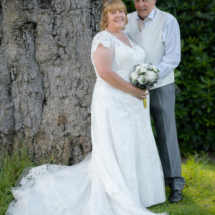 Bride and Groom by tree.