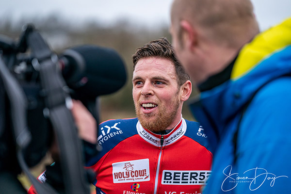 Telephoto shot of BBC spotlight interviewing race winner.