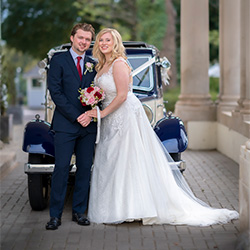 Bride and Groom in front of vintage Rover