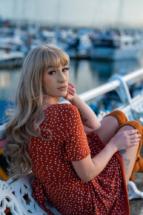 Model sat down at Princess Pier in Torquay.