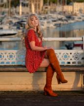 Model sitting down at Princess Pier in Torquay.