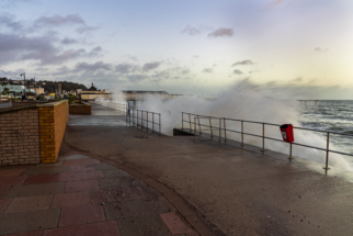 Waves crashing over Teignmouth seafront.
