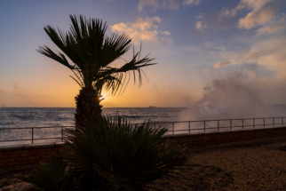 Teignmouth Seafront at sunrise with wave crashing over all
