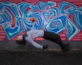 levitation next to graffiti