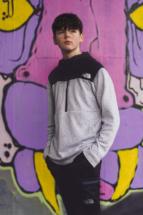 portrait pose next to graffiti wall