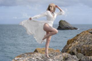 Model posing on rocks at Meadfoot beach, Torquay.