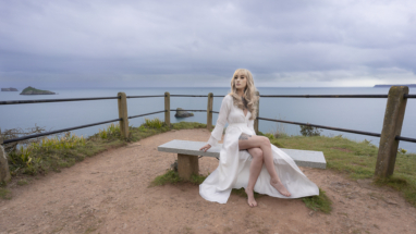 Model sat on lovely granite bench on a coast path in Torquay