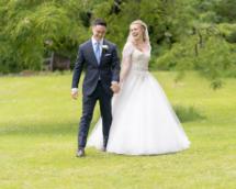Bride and Groom joking on Cockington grounds