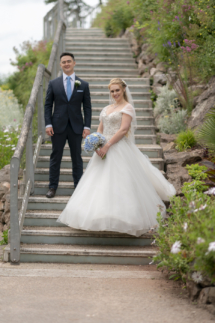 Bride and Groom on stairs at Rock walk in Torquay, Devon.
