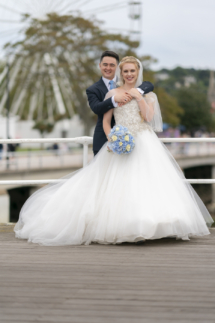 Bride and Groom with Torquay's big wheel behind them