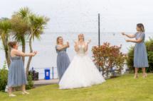 Bride, bridesmaids and confetti cannons.