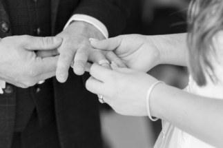 Wedding ring being placed on hand