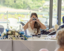 Bride taking a photo of me, the wedding photographer