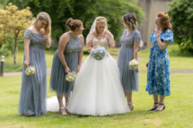 Bride with bridesmaids laughing and joking