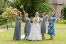 Bride with bridesmaids posing in a funny way.