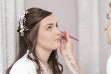 Bridal prep. Bride having makeup done.