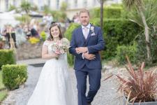 Bride and Dad walking to wedding ceremony