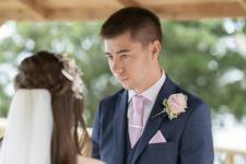 Wedding ceremony. Groom looking at Bride