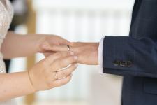 Groom wedding ring going on finger