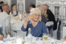 Wedding guest raising a glass